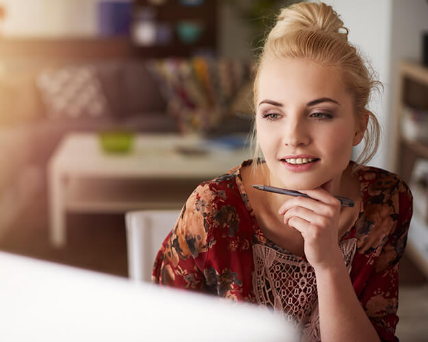 Young creative woman working at home